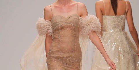 Fashion model, Gown, Dress, Clothing, Fashion, Wedding dress, Bridal party dress, Haute couture, Shoulder, Bridal clothing,