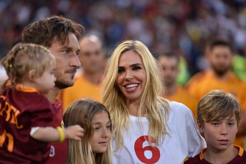 rome, italy   may 28  francesco totti 4th r holds a baby girl as he poses for a photo with his family after the serie a week 38 match between as roma and genoa cfc at stadio olimpico in rome, italy on may 28, 2017 team captain of as roma francesco totti quits soccer, after carrying the yellow red jersey since 1993 thousands of fans, supported totti in the ceremonies ahead of the game and after the game photo by claudio pasquazianadolu agencygetty images