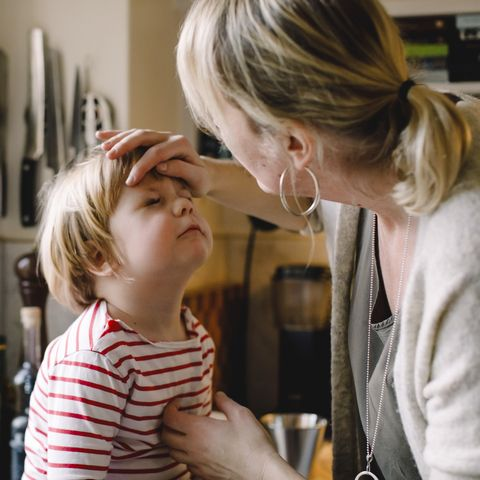 child with tourette syndrome and caring mother