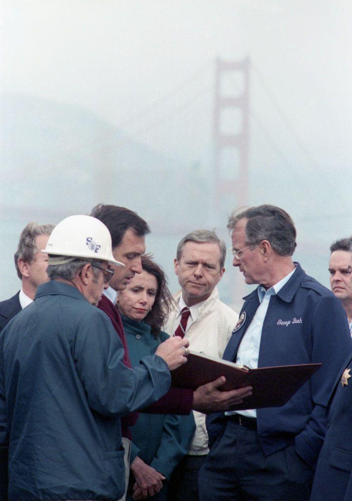 Pelosi surveys the damage done by the Loma Prieta earthquake with President George H.W. Bush.