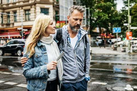 Tourist Couple Out Walking In New City Together