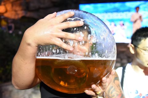 Drinking Beer With Fishbowl Competition In Hangzhou