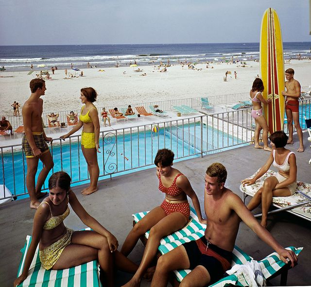 tourists lounging on commander hotel balcony at the beach