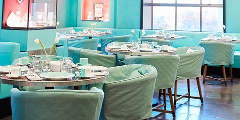 Turquoise, Blue, Room, Green, Restaurant, Aqua, Table, Interior design, Building, Furniture,