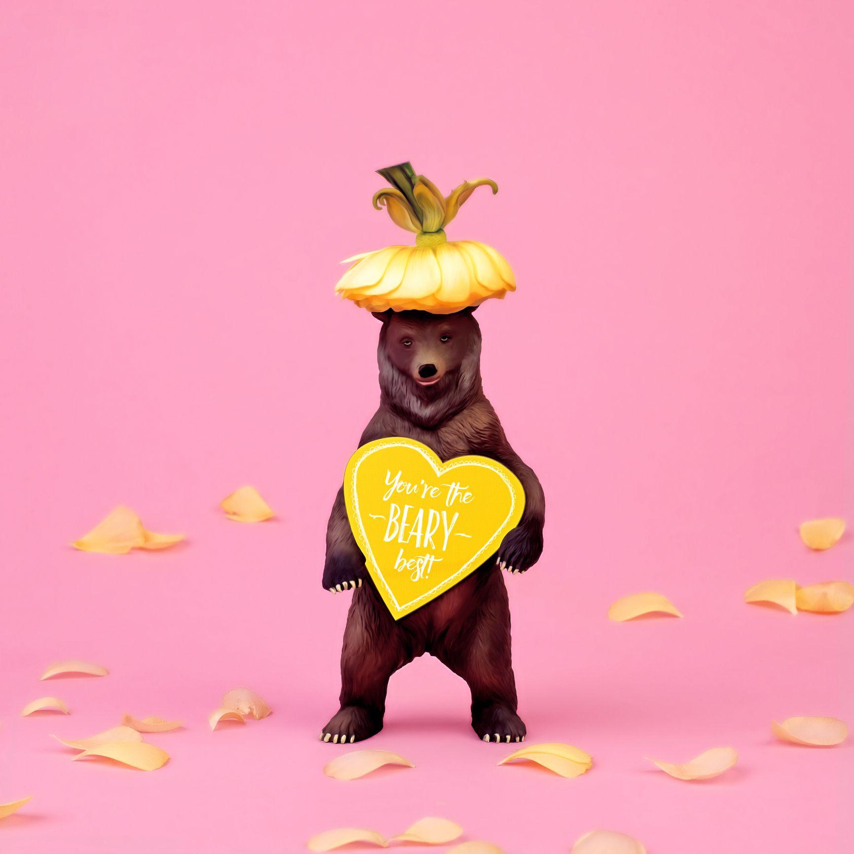 ours en peluche avec coeur et fleur