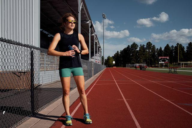 how many laps is a mile   female runner on track