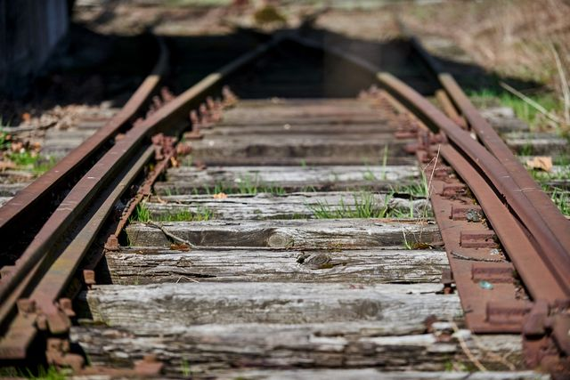 a photo taken on april 9, 2021 shows old train tracks leading past a former canteen building of ss guards at the former nazi germany death camp auschwitz birkenau, in oswiecim, poland   a polish foundation hopes to restore a canteen where ss guards ate and sought distraction after long days of killing at the former nazi germany death camp auschwitz birkenau, to serve as a reminder of the banality of evil built in march 1942 at auschwitz    europe's largest death factory    the massive dining hall could house up to 4,000 people after the war it served as a cereal warehouse before it was abandoned and gradually fell into ruin   to go with afp story by stanislaw waszak photo by bartosz siedlik  afp  to go with afp story by stanislaw waszak photo by bartosz siedlikafp via getty images
