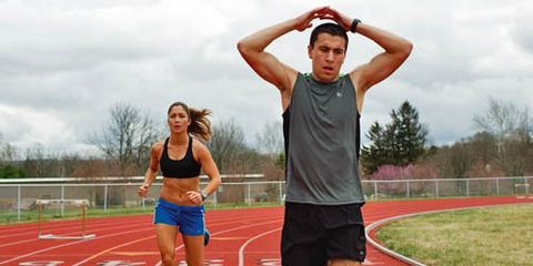 man and woman track workout