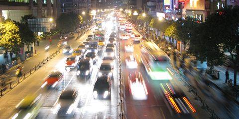 Long-exposure image of late-night highway traffic