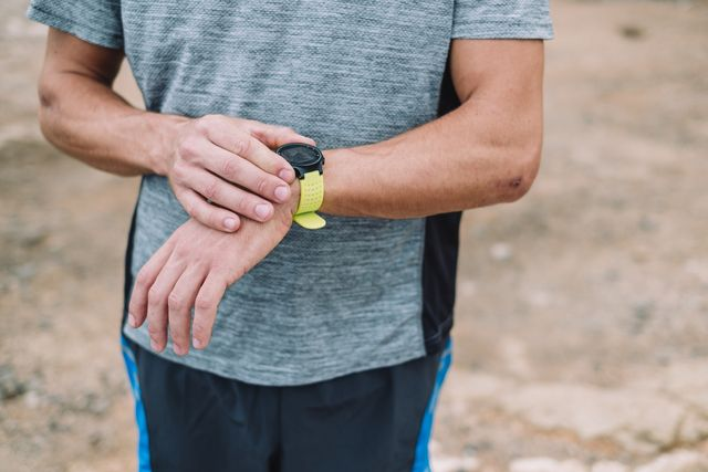trail runner checking fitness tracker,tenerife, canary islands, spain