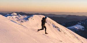 Trail runner makes his way down snowy hill