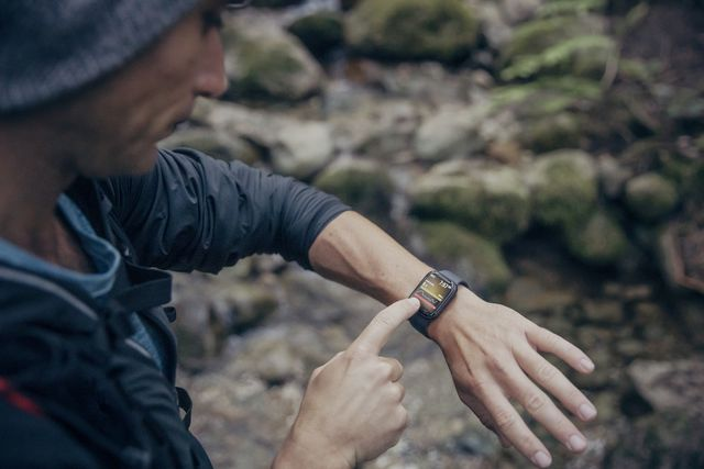 trail runner monitoring blood sugar on smartwatch