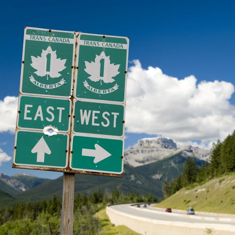 trans canada highway with roadsign through the rocky mountains