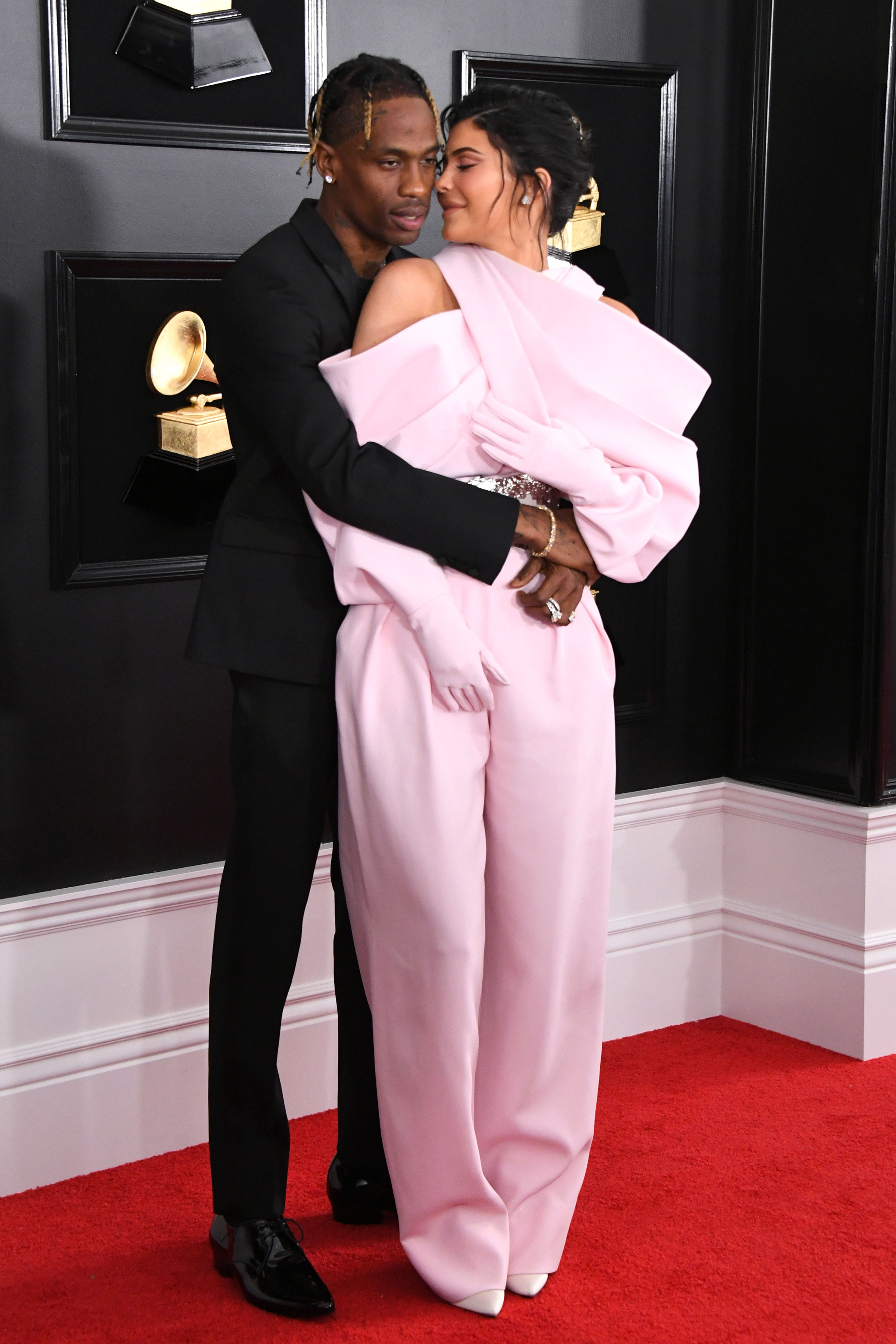 8b9166b7e9b7 Kylie Jenner Wears Pink and Kisses Travis Scott on the Grammys 2019 ...