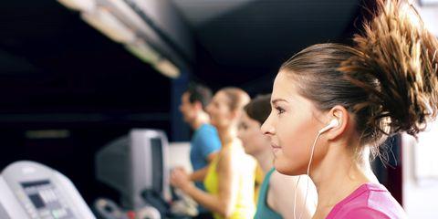 Girl on Treadmill with Headphones