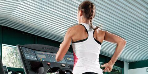 woman running on treadmill