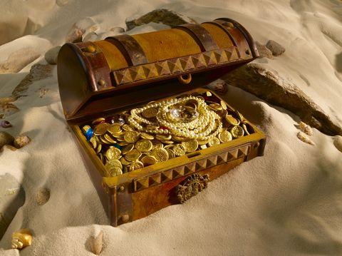 schat, juwelen, zand