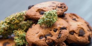 Treatment of medical marijuana for use in food Cookies with cannabis and buds of marijuana on the table.