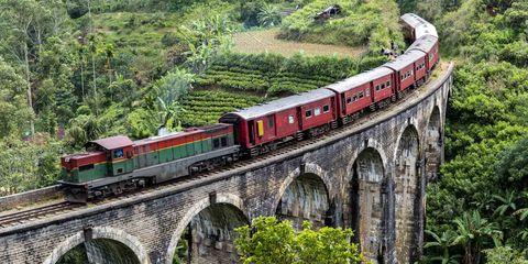 Transport, Arch bridge, Train, Rolling stock, Bridge, Railway, Viaduct, Mode of transport, Vehicle, Track,