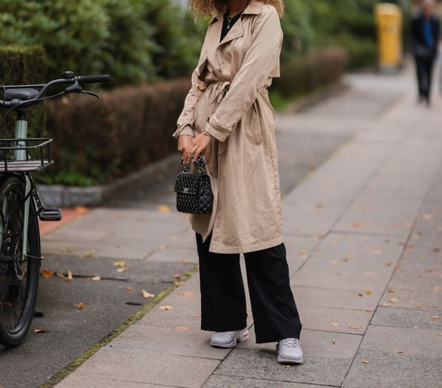 hamburg, germany   september 10 lindsay wearing a beige trench coat, a black bag, black pants and nike sneakers on september 10, 2021 in hamburg, germany footage by photographergetty images photo by jeremy moellergetty images