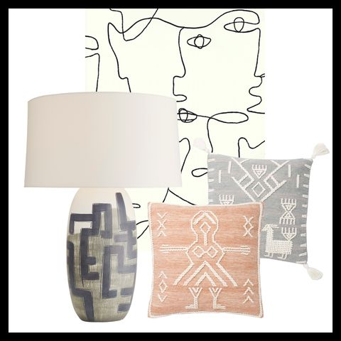 table lamp by arteriors, wallpaper by york wallcoverings and pillows by loloi