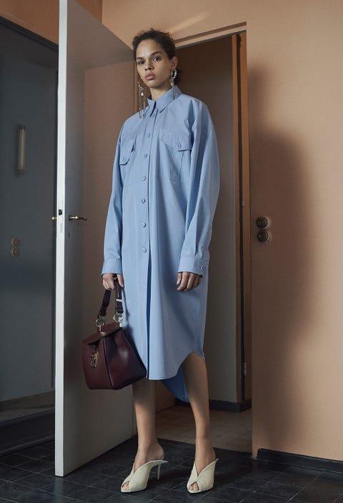 Clothing, Blue, Fashion, Fashion model, Shoulder, Dress, Coat, Trench coat, Street fashion, Outerwear,