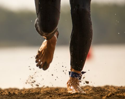 Triathlete runs out of a lake