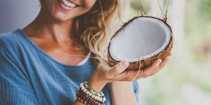 Tribal woman with coconut bowl