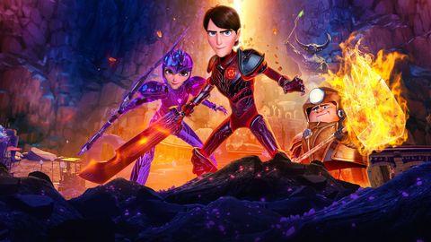 tres amigos luchan con armadura entre el fuego en trollhunters