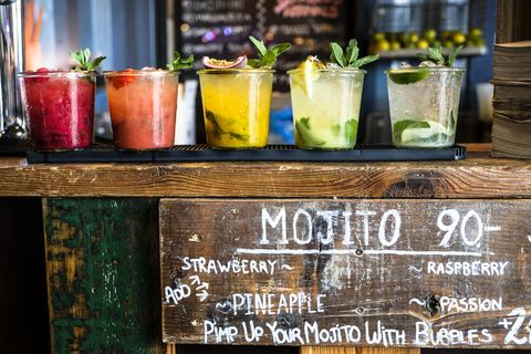 tropical colorful mojito at a wooden bar