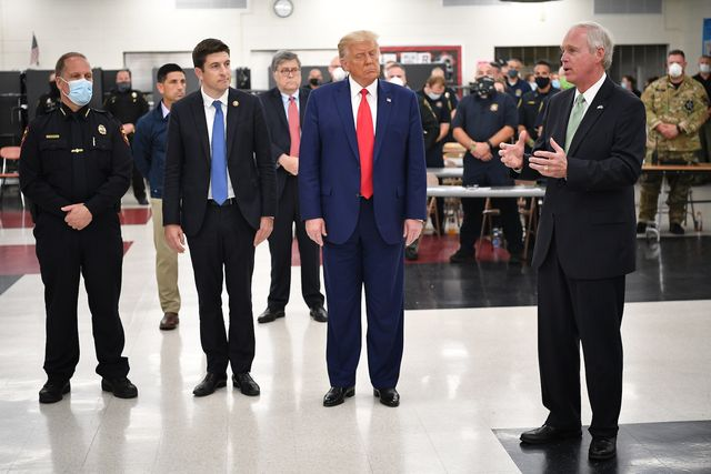 us president donald trump listens to republican senator ron johnson during a tour of an emergency operations center at mary d bradford high school in in kenosha, wisconsin on september 1, 2020   trump visited kenosha, the city at the center of a raging us debate over racism, despite pleas to stay away and claims he is dangerously fanning tensions as a reelection ploy photo by mandel ngan  afp photo by mandel nganafp via getty images