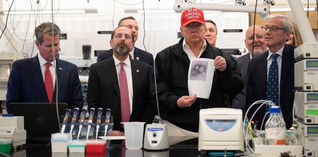 us president donald trump c holds a picture of the coronavirus with us health and human service secretary alex azar 2nd l, cdc director robert redfield 2nd r, and cdc associate director for laboratory science and safety adlss dr steve monroe r during a tour of the centers for disease control and prevention cdc in atlanta, georgia, on march 6, 2020 photo by jim watson  afp photo by jim watsonafp via getty images