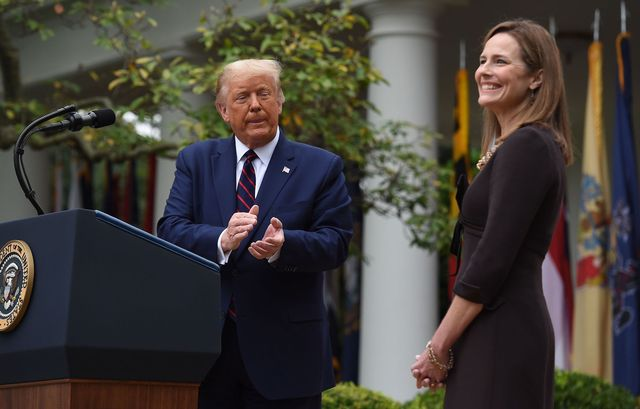 topshot   us president donald trump announces his us supreme court nominee, judge amy coney barrett r, in the rose garden of the white house in washington, dc on september 26, 2020   barrett, if confirmed by the us senate, will replace justice ruth bader ginsburg, who died on september 18 photo by olivier douliery  afp photo by olivier doulieryafp via getty images