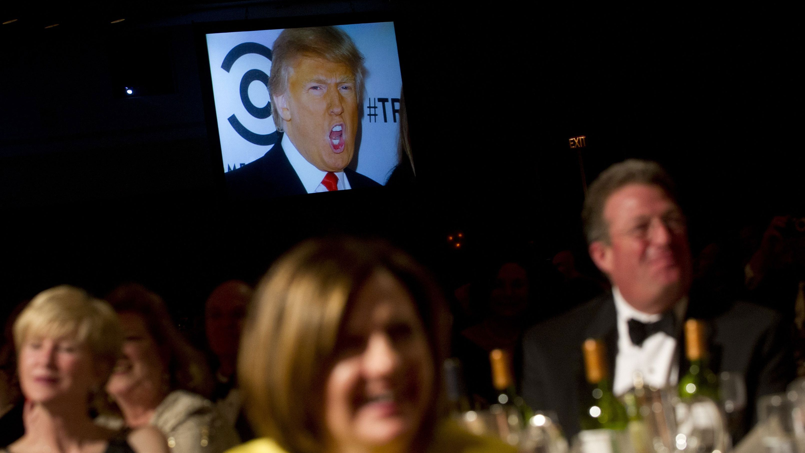 A picture of Donald Trump appeared on a screen as Barack Obama told a joke during the White House Correspondents' Dinner in Washington in 2012.​​