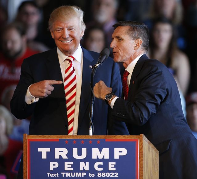 grand junction, co   october 18 republican presidential candidate donald trump l jokes with retired gen michael flynn as they speak at a rally at grand junction regional airport on october 18, 2016 in grand junction colorado trump is on his way to las vegas for the third and final presidential debate against democratic rival hillary clinton photo by george freygetty images
