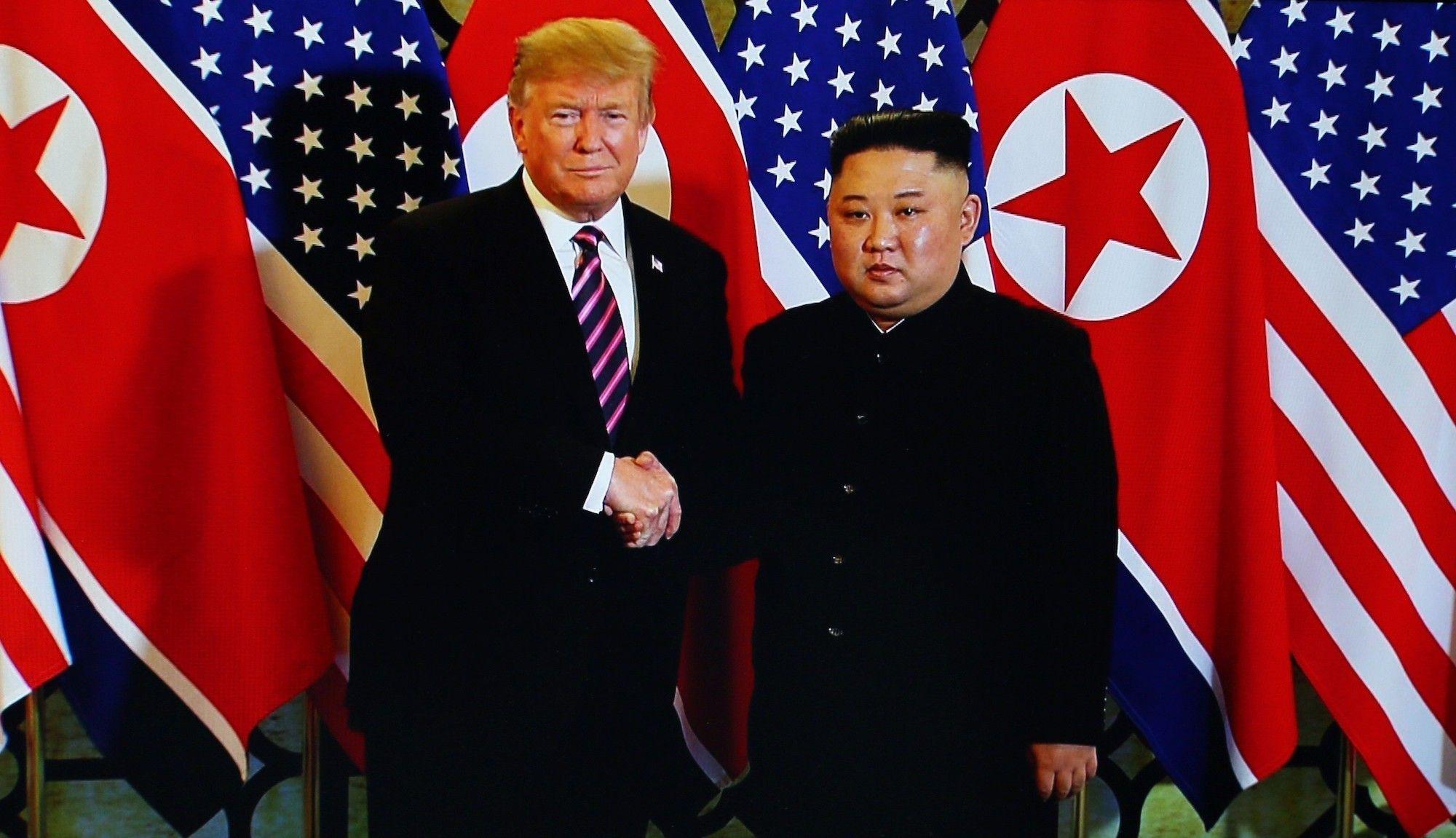 Trump and Kim shake hands in Hanoi.