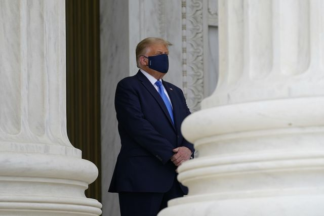washington, dc   september 24 us president donald trump wears a face mask while paying respects as justice ruth bader ginsburg lies in repose under the portico at the top of the front steps of the us supreme court building on september 24, 2020 in washington, dc ginsburg, who was appointed by former us president bill clinton served on the high court from 1993, until her death on september 18, 2020 photo by alex brandon poolgetty images