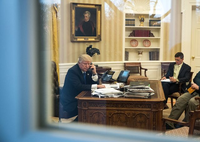 washington, dc   january 28 president donald trump speaks on the phone with australian prime minister malcolm turnbull in the oval office of the white house, january 28, 2017 in washington, dc also pictured at right, national security advisor michael flynn and white house chief strategist steve bannon on saturday, president trump is making several phone calls with world leaders from japan, germany, russia, france and australia photo by drew angerergetty images