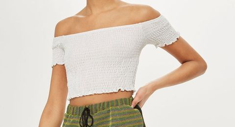 Clothing, Shoulder, Joint, Arm, Crop top, Neck, Sleeve, Elbow, Waist, Human body,