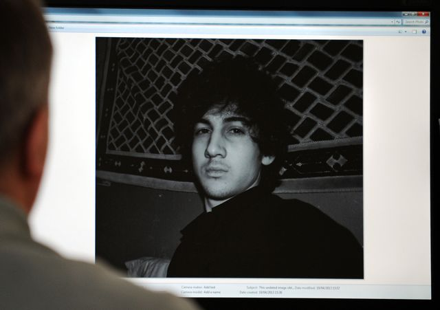 a man looks in moscow on april 19, 2013, at a computer screen displaying an undated picture the 19 year old dzhokhar tsarnaev posted on his  is page in vkontakte, a russian social media site dzhokhar tsarnaev is the subject of a april 19, 2013 manhunt in the boston area one of the boston marathon bombing suspects was killed in a shootout early april 19 as police raced on a house to house search for the second, with the entire city placed on lockdown nbc news reported that the two young men believed to be responsible for monday's deadly carnage at the finish line of the prestigious race are brothers of chechen origin who were permanent legal residents of the united states afp photo        photo credit should read  afp via getty images