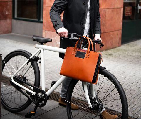 Bicycle wheel, Bicycle part, Bicycle, Orange, Bicycle handlebar, Bicycle accessory, Street fashion, Bicycle drivetrain part, Bag, Vehicle,