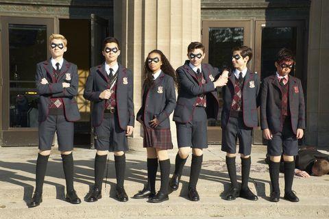 Photograph, Uniform, Social group, Standing, Fashion, Footwear, School uniform, Fun, Riding boot, Kilt,
