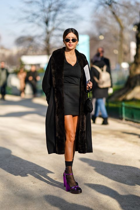 Street fashion, Fashion, Clothing, Fur, Fashion model, Snapshot, Footwear, Fashion show, Knee, Outerwear,