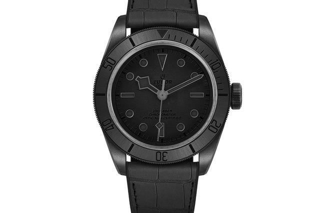 Watch, Analog watch, Watch accessory, Black, Strap, Fashion accessory, Jewellery, Material property, Brand, Hardware accessory,