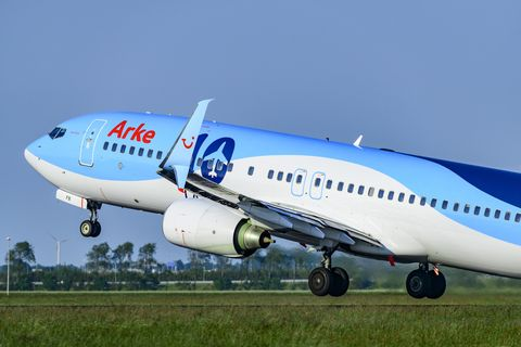 tui airlines arke boeing 737 airplane taking off from amsterdam schiphol airport