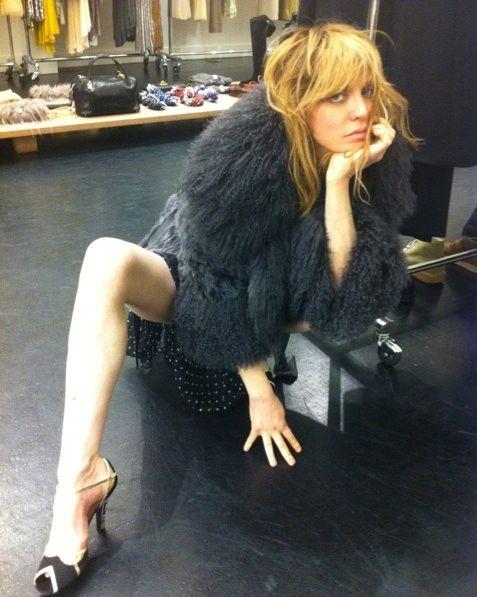 Leg, Long hair, Photo shoot, Little black dress, Sitting, Footwear, Dress, Thigh, Human leg, Photography,