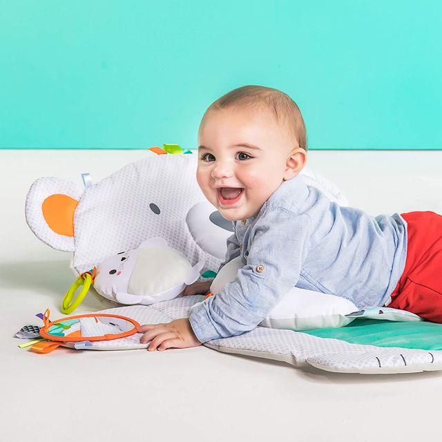 baby laying on bright starts polar bear tummy time mat