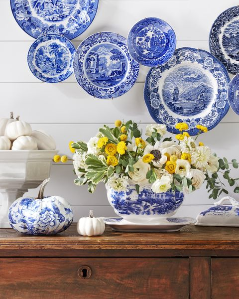 blue transferware tureen filled with yellow and white flowers