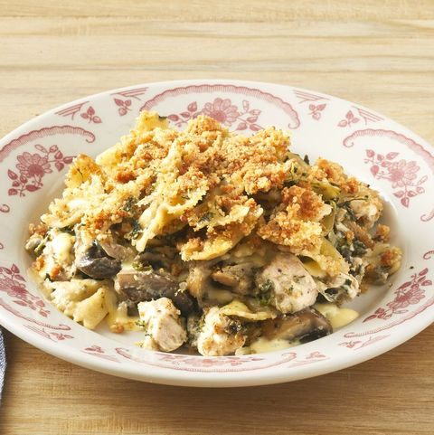 turkey tetrazzini in white and red bowl