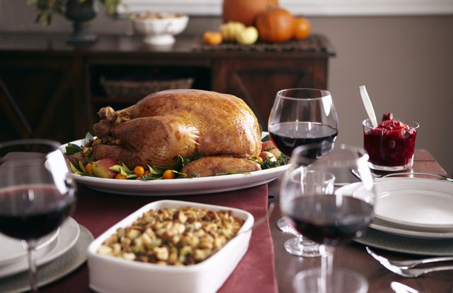 turkey, stuffing, and cranberry dishes on table